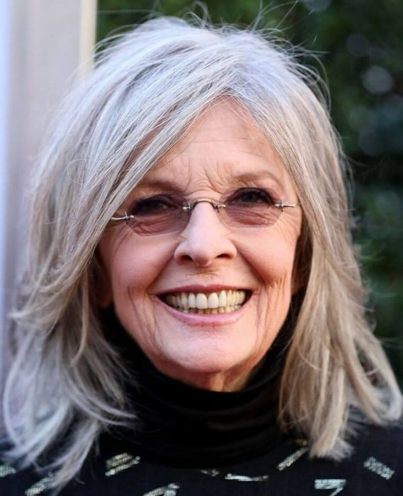 Actress Diane Keaton paired her medium hair with gray highlights with rimless glasses