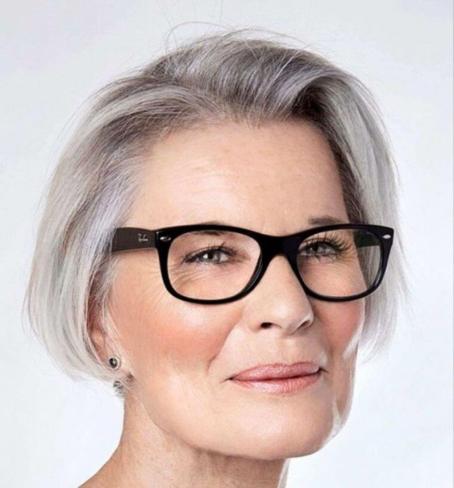 Hairstyle highlighting the face and her glasses with black frames