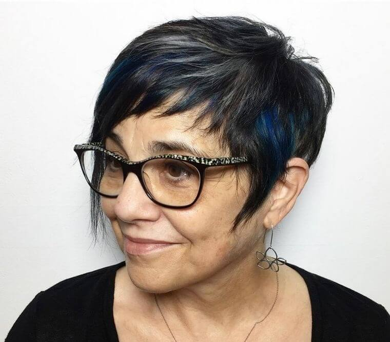 Hairstyle in black with blue highlights.