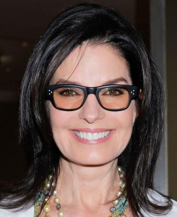 Medium length hair in black with glasses of the same color