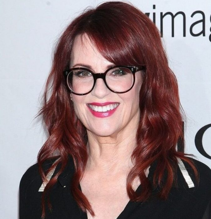 Medium length hairstyles for women over 50 with glasses