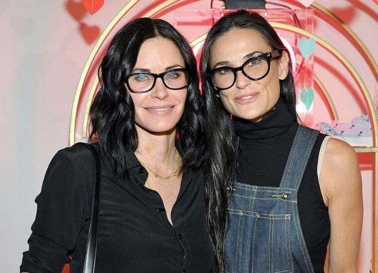 Women over 50 with glasses showing off long hair